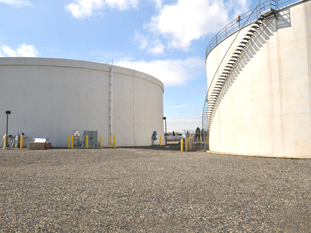 In addition to this concentrated storage tank, two dilute storage tanks are being constructed on the west side of the PDX airfield.  They consist of concrete and steel-walled panels wrapped in a combination of concrete, rebar, and braided cable designed to keep the tanks seismically sound.  This project will more than double the strage capacity for stormwater containing deicing materials.