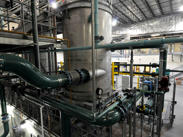Another interior view of the treatment plant, with an up-close shot of one of the seperators.  The two seprators in the facility remove carbon from treated deicing material for eventual return to the reactors.