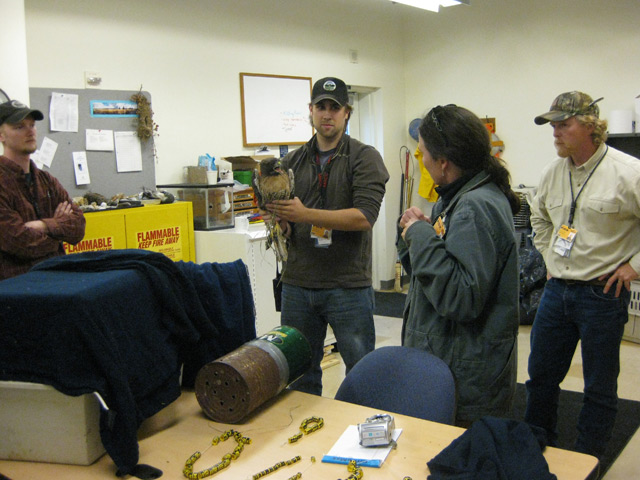 The PDX wildlife team, Erick Shore, John Hilterbrand, and Alex Lauber during a training session instructed by Carole Hallett. All captured raptors are banded before they are relocated.