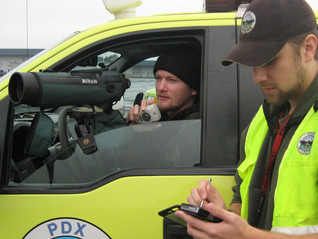 PDX wildlife technicians Erick Shore and John Hilterbrand assessing the wildlife risk to aviation safety.