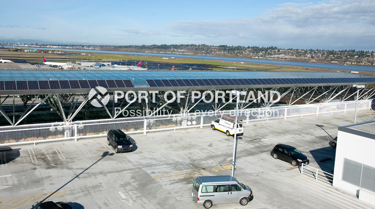 These solar panels, installed on the glass canopy covering the PDX terminal roadway, produce a total of 30,000 kilowatt-hours of energy per year.