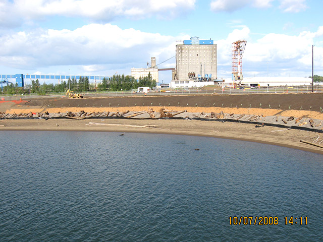 Wheeler Bay: Overview of completed slope, looking north, with former Cargill grain facility in background.