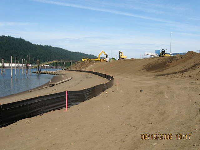 Wheeler Bay: Slope being re-graded to a gentler and more stable angle. Black silt fence delineates work area to avoid erosion during construction.