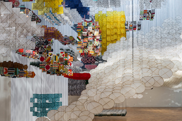 Jacob Hashimoto in front of Concourse E wall