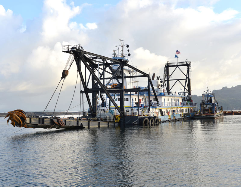 The Dredge Oregon navigation vessel floats on top of the Columbia River