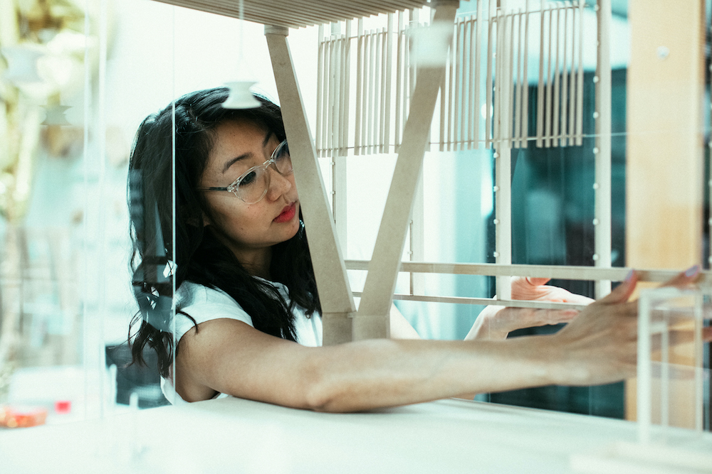 Talisa Shevavesh of architecture firm ZGF works in her studio on models of new airport designs